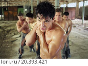 Купить «five healthy young guys with force pulling ropes load in abandoned building», фото № 20393421, снято 10 мая 2014 г. (c) Losevsky Pavel / Фотобанк Лори