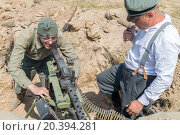 Купить «NELIDOVO, RUSSIA- JULY 12, 2014: Battlefield 2014: two Nazi soldier with a machine gun in a trench», фото № 20394281, снято 12 июля 2014 г. (c) Losevsky Pavel / Фотобанк Лори