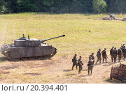 Купить «NELIDOVO, RUSSIA- JULY 12, 2014: Battlefield 2014: Nazi tank and infantry unit», фото № 20394401, снято 12 июля 2014 г. (c) Losevsky Pavel / Фотобанк Лори