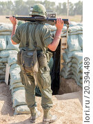 Купить «GI with assault rifle in front of the dugout», фото № 20394489, снято 12 июля 2014 г. (c) Losevsky Pavel / Фотобанк Лори