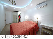 Купить «Interior new bedroom with double bed, bedside table and open sliding door wardrobe», фото № 20394621, снято 24 мая 2014 г. (c) Losevsky Pavel / Фотобанк Лори