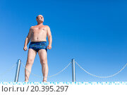 Купить «elderly man stands near the pool fenced chains», фото № 20395297, снято 23 июля 2014 г. (c) Losevsky Pavel / Фотобанк Лори