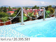 Blue swimming pool on the rooftop before surrounding area, фото № 20395581, снято 25 июля 2014 г. (c) Losevsky Pavel / Фотобанк Лори