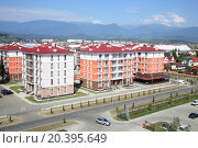 Купить «SOCHI, RUSSIA - JUL 25, 2014: The view from the Hotel Radisson Blu Paradise Resort and Spa to the street 65 years of Victory with new housing estate and mountains», фото № 20395649, снято 25 июля 2014 г. (c) Losevsky Pavel / Фотобанк Лори