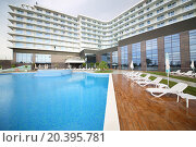 Купить «SOCHI, RUSSIA - JUL 27, 2014: Area of the Hotel Radisson Blu Paradise Resort and Spa near the outdoor pool», фото № 20395781, снято 27 июля 2014 г. (c) Losevsky Pavel / Фотобанк Лори