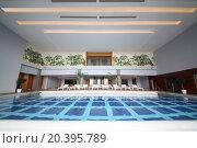 Купить «SOCHI, RUSSIA - JUL 27, 2014: Room with an indoor pool and sun loungers in the Hotel Radisson Blu Paradise Resort and Spa», фото № 20395789, снято 27 июля 2014 г. (c) Losevsky Pavel / Фотобанк Лори