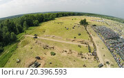 Купить «RUSSIA, NELIDOVO - JUL 12, 2014: Filed with soldiers formation and tribune with spectators during reconstruction Battlefield at sunny summer day. Aerial view. Photo with noise from action camera», фото № 20396593, снято 12 июля 2014 г. (c) Losevsky Pavel / Фотобанк Лори