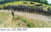 Купить «RUSSIA, NELIDOVO - JUL 12, 2014: Troops in uniform of german army on field with armour carrier during reconstruction Battlefield. Aerial view. Photo with noise from action camera», фото № 20396597, снято 12 июля 2014 г. (c) Losevsky Pavel / Фотобанк Лори