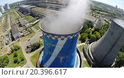Купить «RUSSIA, MOSCOW - JUL 14, 2014: Vapour goes out from cooling tower of electricity station. Aerial view. Photo with noise from action camera.», фото № 20396617, снято 14 июля 2014 г. (c) Losevsky Pavel / Фотобанк Лори