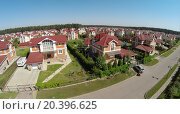Купить «Aerial view of cottage town near forest at the sunny summer day.», фото № 20396625, снято 5 июня 2014 г. (c) Losevsky Pavel / Фотобанк Лори