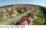 Купить «Aerial view of many similar houses in cottage settlement at sunny summer day.», фото № 20396629, снято 5 июня 2014 г. (c) Losevsky Pavel / Фотобанк Лори