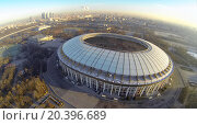 Купить «MOSCOW - FEB 26, 2014: Cityscape with reconstruction of soccer complex Luzhniki at sunny day. Aerial view», фото № 20396689, снято 26 февраля 2014 г. (c) Losevsky Pavel / Фотобанк Лори
