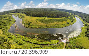 Купить «RUSSIA, NICOLA-LENIVETS - JUL 6, 2014: River shore in Wonderland Park during 9th Festival of landscape objects Archstoyanie. Aerial view. Photo with noise from action camera.», фото № 20396909, снято 6 июля 2014 г. (c) Losevsky Pavel / Фотобанк Лори
