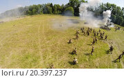 Купить «RUSSIA, NELIDOVO - JUL 12, 2014: Assault of Soviet soldiers with tanks during reconstruction Battlefield at Second World war. Aerial view. (Photo with noise from action camera)», фото № 20397237, снято 12 июля 2014 г. (c) Losevsky Pavel / Фотобанк Лори