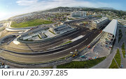Купить «RUSSIA, SOCHI – JUL 28, 2014: Building site of stadium for racing near town and mountains at summer sunny day. Aerial view. (Photo with noise from action camera)», фото № 20397285, снято 28 июля 2014 г. (c) Losevsky Pavel / Фотобанк Лори