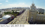 Купить «RUSSIA, MOSCOW - MAY 23, 2014: Cityscape with highway traffic near edifice of Hotel Pekin with facade clock at spring sunny day. Aerial view.», фото № 20397513, снято 23 мая 2014 г. (c) Losevsky Pavel / Фотобанк Лори