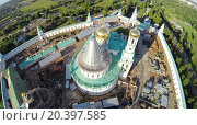 Купить «RUSSIA, MOSCOW – JUL 12, 2014: Construction site of New-Jerusalem Monastery with Christ Resurrection Cathedral at summer sunny day. Aerial view (Photo with noise from action camera)», фото № 20397585, снято 12 июля 2014 г. (c) Losevsky Pavel / Фотобанк Лори