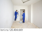Купить «Two workers in blue clothes paint walls on ladder in new apartment», фото № 20404669, снято 11 декабря 2013 г. (c) Losevsky Pavel / Фотобанк Лори