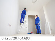 Купить «Young workers in blue clothes glue paint fiberglass on ladder in new apartment», фото № 20404693, снято 11 декабря 2013 г. (c) Losevsky Pavel / Фотобанк Лори