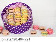 Купить «Colorful cookies with cream on table and in polka dots box», фото № 20404721, снято 2 апреля 2014 г. (c) Losevsky Pavel / Фотобанк Лори