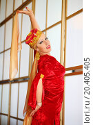 Купить «Young woman in red Andalusian costume poses with shawls», фото № 20405405, снято 7 мая 2014 г. (c) Losevsky Pavel / Фотобанк Лори