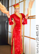 Купить «Young woman in red Andalusian costume dances with yellow shawls», фото № 20405413, снято 7 мая 2014 г. (c) Losevsky Pavel / Фотобанк Лори