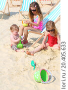 Купить «Three happy children sit on beach and play with toys at sunny summer day.», фото № 20405633, снято 13 мая 2013 г. (c) Losevsky Pavel / Фотобанк Лори