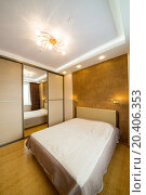 Купить «Modern bedroom with closet, large mirror and chandelier.», фото № 20406353, снято 14 января 2014 г. (c) Losevsky Pavel / Фотобанк Лори