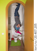 Купить «Father with daughter upside down on the ceiling in toilet at inverted house», фото № 20407205, снято 22 января 2014 г. (c) Losevsky Pavel / Фотобанк Лори