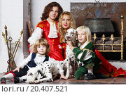 Купить «Happy father, mother and two sons in medieval costumes sit with two dalmatians near fireplace.», фото № 20407521, снято 2 ноября 2013 г. (c) Losevsky Pavel / Фотобанк Лори