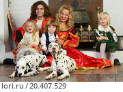 Купить «Happy father, mother, little daughter and two sons in medieval costumes sit with two dalmatians near fireplace.», фото № 20407529, снято 2 ноября 2013 г. (c) Losevsky Pavel / Фотобанк Лори