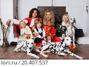 Купить «Fun father, mother, little daughter and two sons in medieval costumes sit with three dalmatians near chimney with boiler.», фото № 20407537, снято 2 ноября 2013 г. (c) Losevsky Pavel / Фотобанк Лори