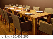 Купить «Served table with armchairs around in cafe», фото № 20408205, снято 27 июня 2013 г. (c) Losevsky Pavel / Фотобанк Лори