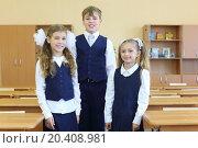 Купить «Two happy girls and boy in uniform stand in classroom at school.», фото № 20408981, снято 17 августа 2013 г. (c) Losevsky Pavel / Фотобанк Лори