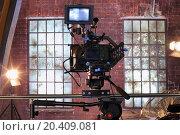 Купить «Camera with special devices for shooting video on rail in studio with windows.», фото № 20409081, снято 21 февраля 2013 г. (c) Losevsky Pavel / Фотобанк Лори