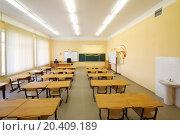 Купить «Empty classroom with wooden desks, chalk board and yellow walls in school.», фото № 20409189, снято 17 августа 2013 г. (c) Losevsky Pavel / Фотобанк Лори