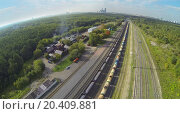 Trains on railway among forest at sunny day. View from unmanned quadrocopter. (2013 год). Редакционное фото, фотограф Losevsky Pavel / Фотобанк Лори