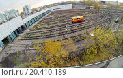 Купить «Waggon near the gates of metro depot, view from unmanned quadrocopter.», фото № 20410189, снято 17 октября 2013 г. (c) Losevsky Pavel / Фотобанк Лори