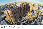 Купить «RUSSIA, MOSCOW - JAN 20, 2014: Aerial view to high-rise residential buildings at Cascade housing complex with roads in winter.», фото № 20410617, снято 20 января 2014 г. (c) Losevsky Pavel / Фотобанк Лори
