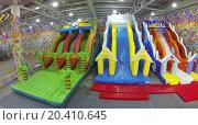 Купить «MOSCOW, RUSSIA - DEC 21, 2013: (aerial view) Inflatable slides in Crocus city hall before New Year», фото № 20410645, снято 21 декабря 2013 г. (c) Losevsky Pavel / Фотобанк Лори