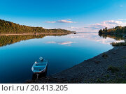 Autum forest reflection in the ocean, with small boat in the foreground. Стоковое фото, фотограф 3523Studio / easy Fotostock / Фотобанк Лори