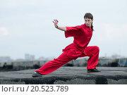 Купить «Shaolin warriors wushoo man in red practice martial art outdoor. Kung fu», фото № 20523789, снято 10 августа 2011 г. (c) easy Fotostock / Фотобанк Лори