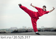 Купить «Shaolin warriors wushoo man in red practice martial art outdoor. Kung fu», фото № 20525317, снято 10 августа 2011 г. (c) easy Fotostock / Фотобанк Лори