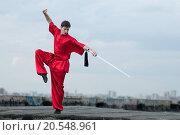Купить «Shaolin warriors wushoo man in red with sword practice martial art outdoor. Kung fu», фото № 20548961, снято 10 августа 2011 г. (c) easy Fotostock / Фотобанк Лори