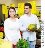 Купить «Portrait of young couple buying vegetables», фото № 20556301, снято 19 сентября 2018 г. (c) Яков Филимонов / Фотобанк Лори