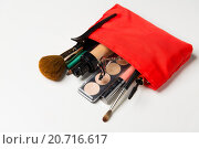 Купить «close up of cosmetic bag with makeup stuff», фото № 20716617, снято 19 ноября 2015 г. (c) Syda Productions / Фотобанк Лори