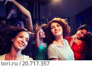 Купить «smiling friends dancing in club», фото № 20717357, снято 20 октября 2014 г. (c) Syda Productions / Фотобанк Лори