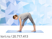 Купить «woman making yoga intense stretch pose on mat», фото № 20717413, снято 13 ноября 2015 г. (c) Syda Productions / Фотобанк Лори