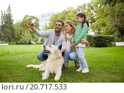 Купить «happy family with dog taking selfie by smartphone», фото № 20717533, снято 20 сентября 2015 г. (c) Syda Productions / Фотобанк Лори