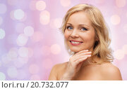 Купить «smiling woman with bare shoulders touching face», фото № 20732077, снято 27 ноября 2015 г. (c) Syda Productions / Фотобанк Лори